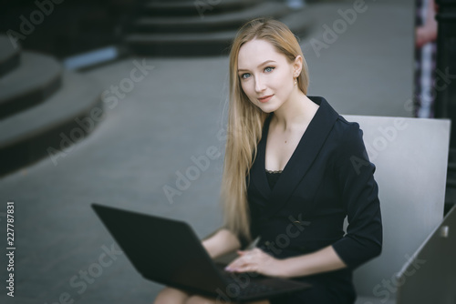Young businesswoman working at laptop. Selective focus. - 227787831