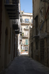 Palermo, Italy - September 08, 2018 : View of a narrow street of Palermo