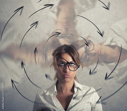 Leinwandbild Motiv Confused businesswoman has dizziness. Concept of stress and overwork
