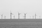 An image of a North Sea wind farm as seen from the balcony of a cruise ship on a very grey day.