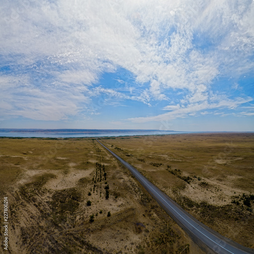 Sandy desert and marshy shores of Zaisan Lake, East Kazakhstan.