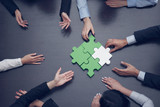 Business people assembling puzzle - 227801221