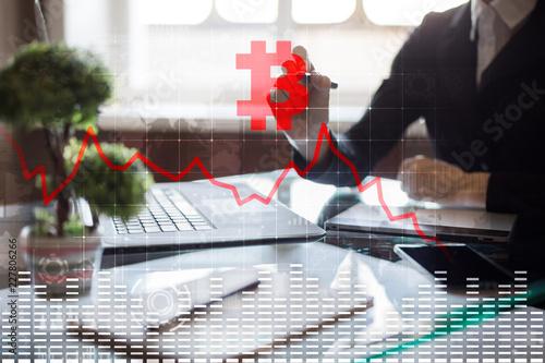 Kryptowalutowy kryzys na wirtualnym ekranie. Bitcoin i Ethereum spadają.