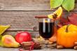 Leinwandbild Motiv Autumn still life with pumpkins and mulled wine