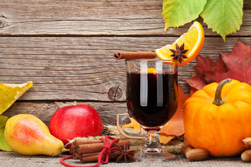 Autumn still life with pumpkins and mulled wine