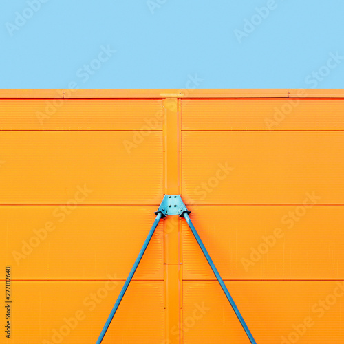 Colorful metal construction detail of industrial architecture with blue sky on the top, geometric abstract background picture © BOOCYS