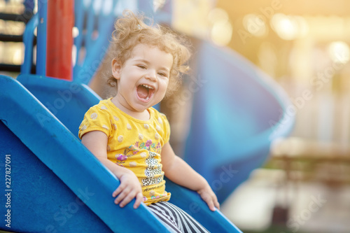 Foto Murales Little Toddler Playing At Playground Outdoors In Summer