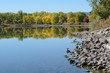 Colorado Front Range lake landscape with autumn trees with reflection and rocky shoreline