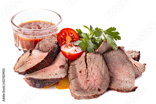 Roasted sliced meat isolated on a white background. - 227829435