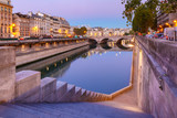 Beautiful view of Seine and Pont Neuf during morning blue hour in Paris, France