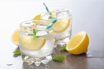 two glasses of lemonade on gray background