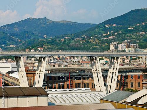 Fototapeta Motorway viaduct over industrial area.