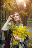 woman portret in autumn leaf - 227856452