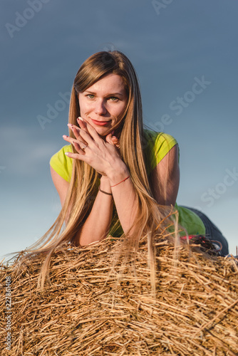 Leinwanddruck Bild Young woman outdoors in a corn field