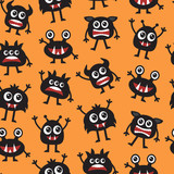 seamless orange background with black cute monsters - 227875600
