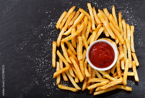 Foto Murales French fries with ketchup, top view