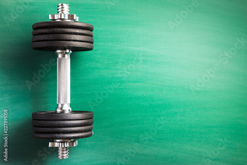 Sticker Dumbbell with black weight.