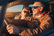 Elderly loving couple traveling in car on vacation.