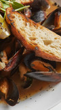 Seafood. Mussels in wine with croutons and lemon. Clams in the shells. - 227901210