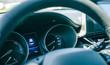 Detail of car dashboard, odometer and steering wheel