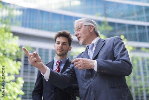 Fridge magnet Business people having a conversation outdoors