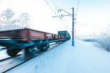 Winter railway and train with cargo.