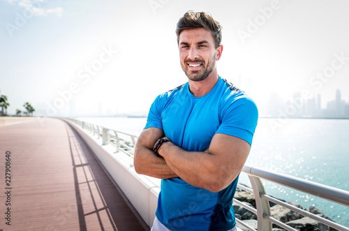 Poster Beautiful man doing work out and different exercises outdoor