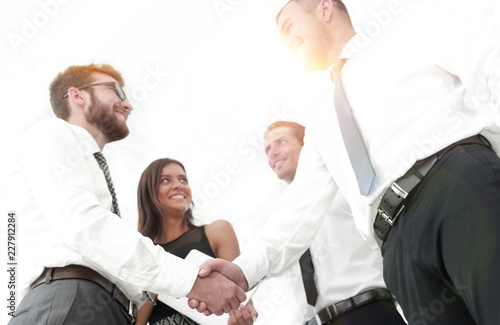 bottom view of handshake of business partners in the office