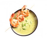king prawns and green vegetable cream soup isolated on a white background, top view from above, copy space - 227922082