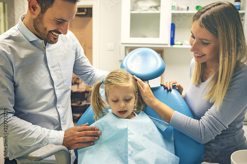 Family in dental office - 227923226