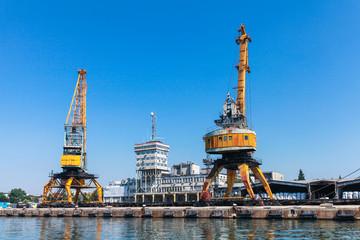 Yellow port cranes in Burgas port. Bulgaria