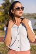 Beautiful woman wearing sunglasses posing at outdoor