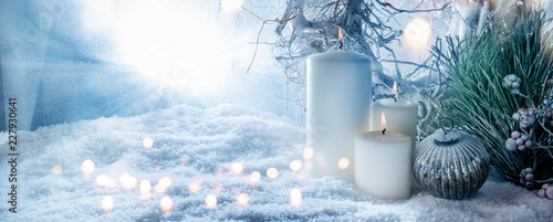 Leinwanddruck Bild Winter decoration in snow with golden bokeh