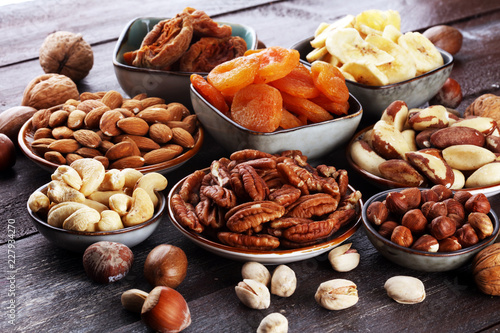 Foto Murales dried fruits and assorted nuts composition on rustic table