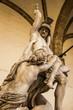 Quadro Rape of Polyxena Trojan War Statue Loggia dei Lanza Piazza della Signoria Florence Italy. Polyxena Rape statue created 1866 by Pio Fedi, Italian Sculptor.