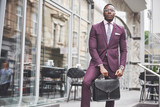 Portrait of a young beautiful African American businessman with a briefcase. Business meeting. - 227953004