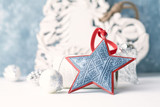 Vintage Christmas ornaments. Christmas star.  Symbolic image. Christmas background. White - blue background. Close up. Copy space.  - 227959693