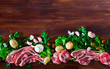 Raw  mutton and vegetables assortment on natural wooden background