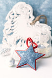 Vintage Christmas ornaments. Christmas star.  Symbolic image. Christmas background. White - blue background. Close up. Copy space.  - 227972863