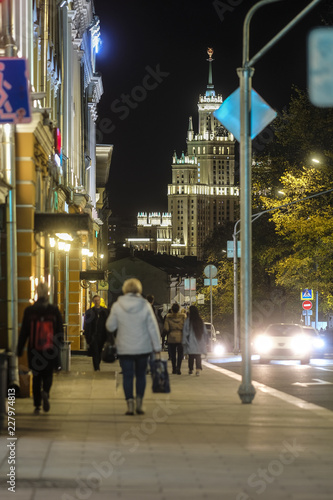 Moscow, Russia - October, 12, 2018: pedestrians on sidewalk in Moscow at night