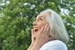 Leinwandbild Motiv Portrait of a happy beautifil elderly woman posing