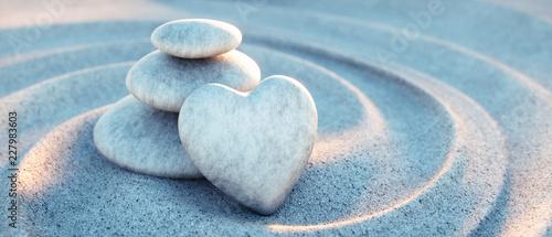 Leinwanddruck Bild Steinturm mit Herz in Sandwellen