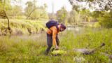 Woman scientist ecologist putting the tool box on the ground - 228001480