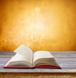 Book on table. Orange background - 228001697