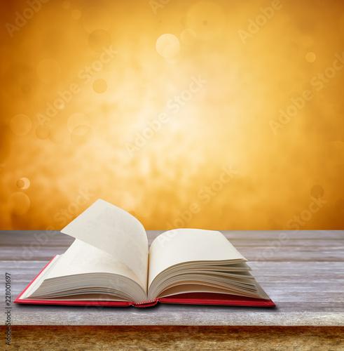 Foto Murales Book on table. Orange background