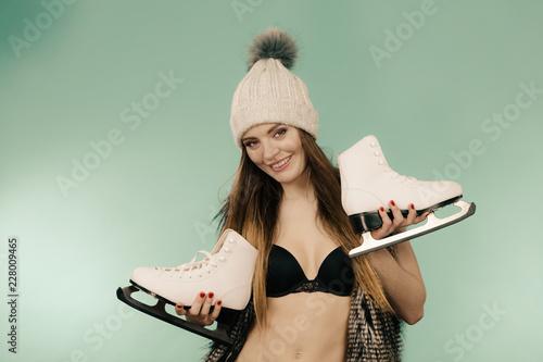 Foto Murales Woman holding ice skates, winter sport