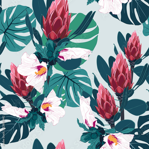 Seamless pattern with tropical leaves and exotic protea and hibiscu flowers. Bright palm leaves on the white background. © Iuliia