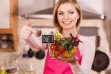 Woman holding shopping backet with vegetables - 228015803