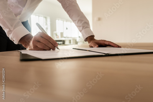 Businessman signing insurance or legal document
