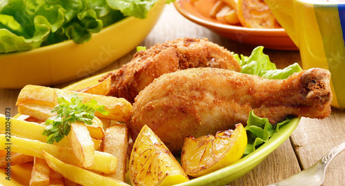 fried chicken with french fries and vegetables - 228024873